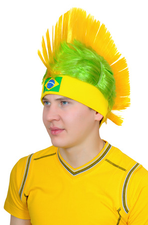 Portrait of a fan of Brazilian national football team Isolated on white background Stock Photo