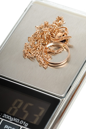 Jewelry made of gold on precision electronic scales Stock Photo