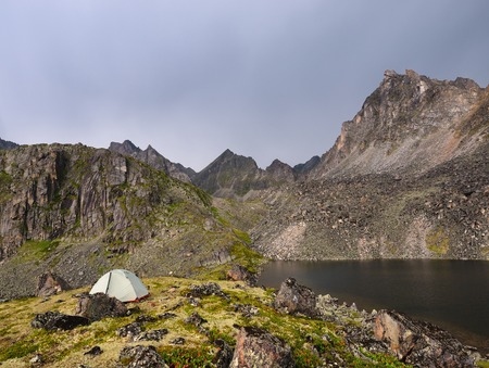 Lonely tourist tent in the mountains of the Eastern Sayan. Republic of Buryatia