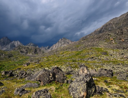 inclement weather: Summer mountain landscape in inclement weather. Sayan mountains. Republic of Buryatia Stock Photo