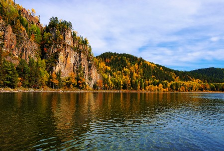 Rock the Siberian river. Autumn in the forest of Eastern Siberia