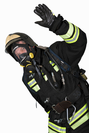 contained: Firefighter in self contained breathing apparatus hand shows gesture OK