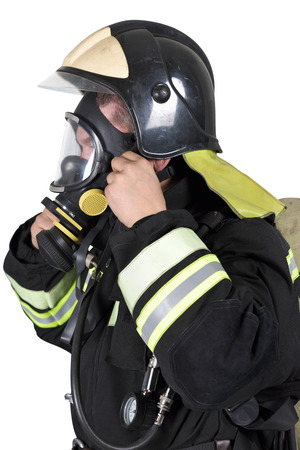 Firefighter corrects overview mask breathing apparatus. Isolated on white Stock Photo