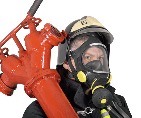 turnout gear: Portrait of a firefighter holding a red hydrant on white