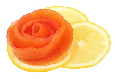 Rose cut tomato on a slice of lemon Stockfoto