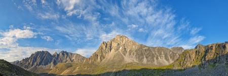 eastern sayan: Beautiful sky over the mountain peaks in July. Eastern Sayan. Siberia