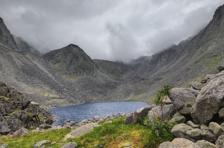 tunka range: A small lake at the bottom of the mountain basin. Eastern Sayan. Buryatia Stock Photo