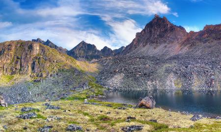 Deepest lake under the mountain peak. Eastern Sayan. Siberia