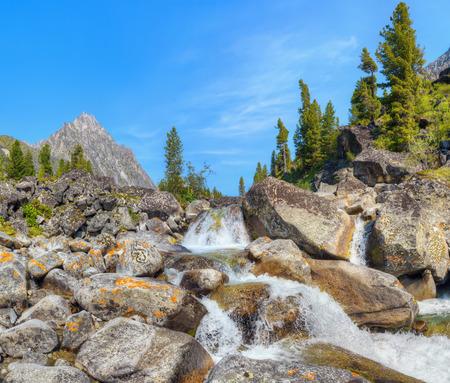 buryatia: Small cascade of waterfalls on a mountain creek. Eastern Sayan. Buryatia
