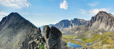 Clastic rock and a view of the mountain valley. TUNKA ridge. Eastern Siberia
