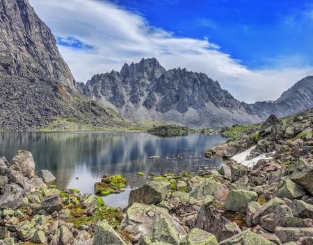 tunka range: Huge fragments of rocks - granite, on the shore of a mountain lake. Tunka range. Siberian Alps. Eastern Siberia Stock Photo