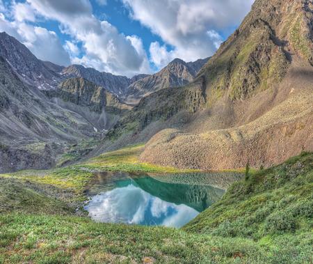 tunka range: The picturesque lake in a small valley below the mountain peak. Eastern Sayan. The Republic Of Buryatia