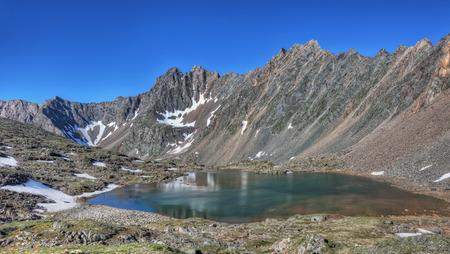 tunka range: Beautiful lake at the foot of the mountain range. Summer morning in the mountains of Eastern Siberia