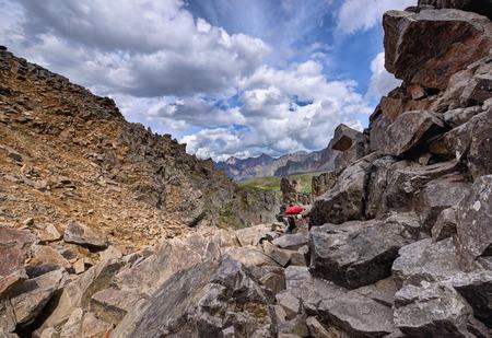tunka range: Mountain tourism. Woman overcomes part of the way to large boulders. Canyon Bilyuty. Eastern Sayan. The Republic Of Buryatia Stock Photo