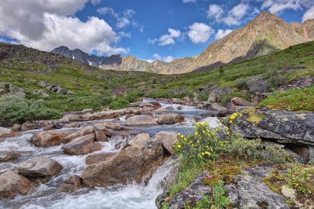 tunka range: A small river in the mountain tundra. Tunka range. Buryatia