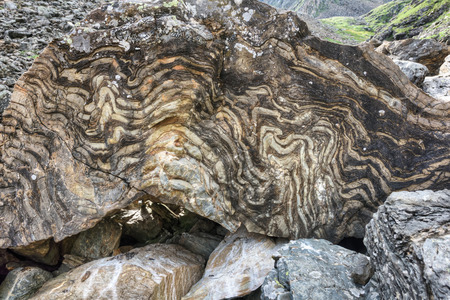 rock layers: Chip metamorphic rock with a layered texture. Location shooting in geotagging file Stock Photo