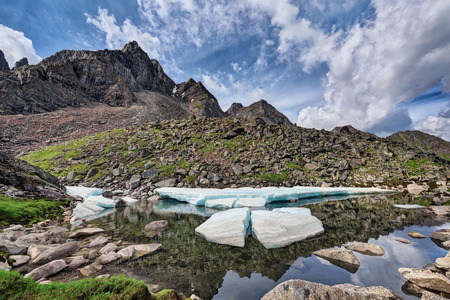 ice floes: Melting ice floes on a small mountain lake. Eastern Sayan. The Republic Of Buryatia