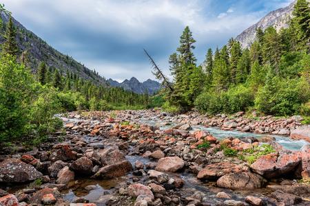 tunka range: Siberian mountain river in early July. Eastern Sayan. Republic of Buryatia Stock Photo