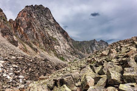 tunka range: Fragments rock breaking mountains covered with lichen. Sayan mountains. Republic of Buryatia