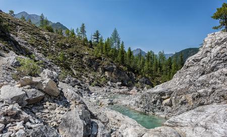 tunka range: Bright rocks in narrow valley of mountain stream. Eastern Sayan. Buryatia Stock Photo