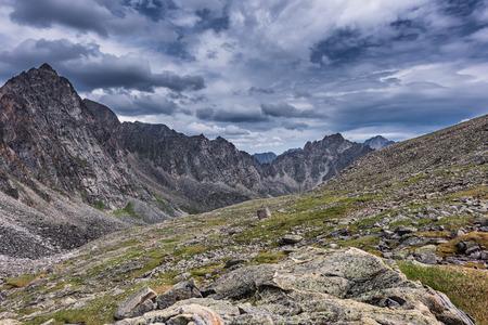 tunka range: Gloomy skies over the slopes of the mountain tundra, in July. Eastern Sayan.The Republic of Buryatia