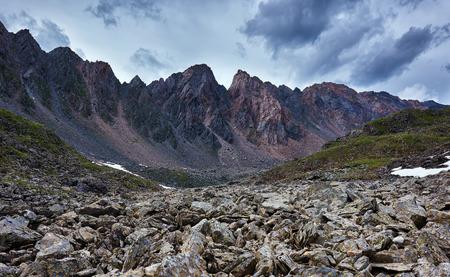 tunka range: The sharp fragments of rock on background of a mountain range. Eastern Sayan. The Republic of Buryatia Stock Photo
