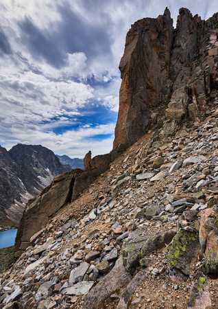 crumbling: Inclined planes descent from the mountain pass and steep crumbling rock in the Eastern Sayan. Siberia