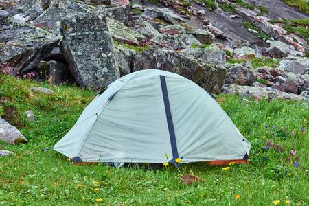 lightweight: Lightweight hiking dome tent on the green grass