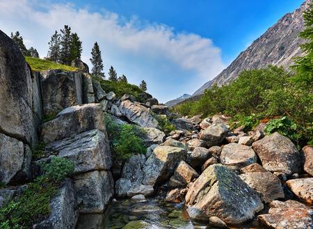 tunka range: Large pieces of rock in a mountain stream. Eastern Sayan. Buryatia