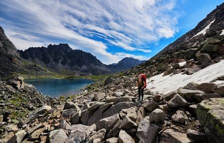 tunka range: Woman on the background of mountain scenery in Siberia. Eastern Sayan. Russia