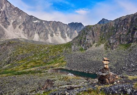 tunka range: Cairn indicating the hiking trails in the mountain tundra. Eastern Siberia. Eastern Sayan Stock Photo