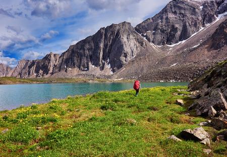 tunka range: Woman leaves the big backpack on the background of wild nature in East Siberia Stock Photo