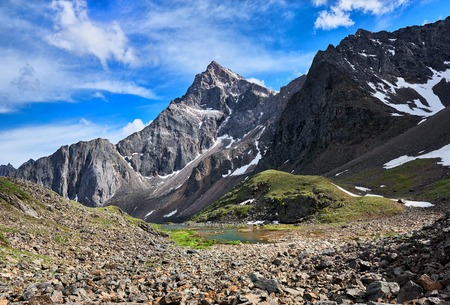 siberia: Pointed peak in the mountains of Eastern Siberia. Summer landscape Stock Photo