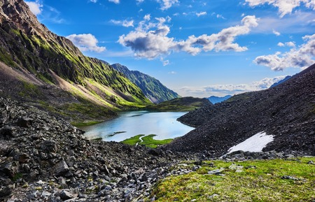 tunka range: Mountain slopes are covered with green grass. Sayan mountains.Russia Stock Photo
