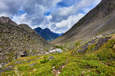 tunka range: It is a small lake between the slopes of the mountains in the tundra of Eastern Siberia Stock Photo