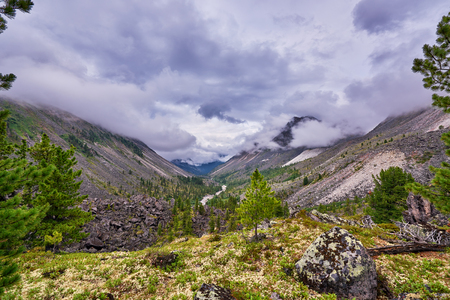 tunka range: Low clouds over a mountain valley . Eastern Siberia. Russia