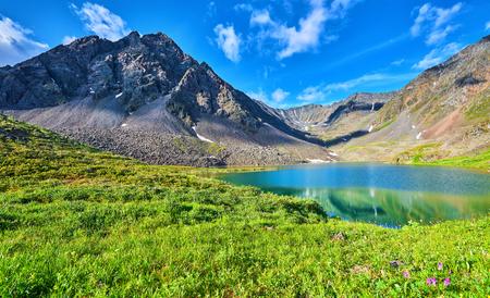 tunka range: Mountain range near the lake and alpine meadow. East Sayan. Buryatiya Stock Photo