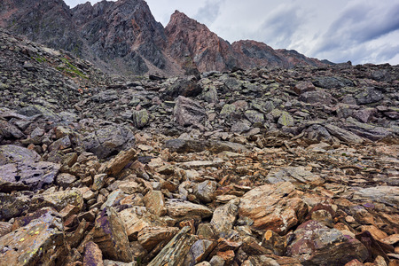 tunka range: Brown pieces of layered rocks riegel moraine bolt in the mountains . Sayan mountains . Russia