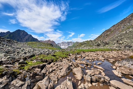 alpine tundra: Fragments of rocks in water. Hanging Valley in the alpine tundra of eastern Siberia . Russia Stock Photo