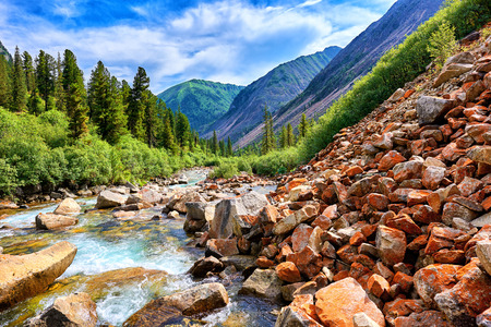 eastern sayan: Scree slope from large fragments covered in red lichen mountain river . Eastern Sayan . Buryatia Stock Photo