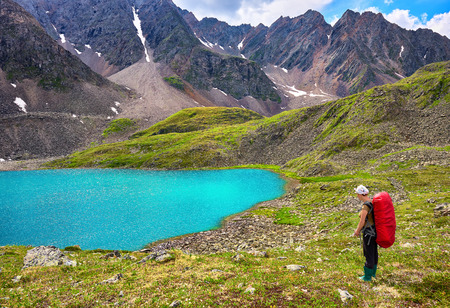 tunka range: Mountain hiking. Woman and pristine Siberian nature in difficult terrain Eastern Sayan . Russia Stock Photo