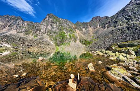 tunka range: Stone bottom clear mountain lake in highlands . Eastern Siberia. Russia