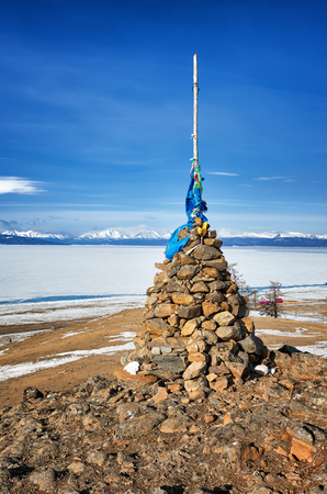 shamanic: Buddhist cairn of clastic rocks on hill of Lake Hovsgol. Mongolia