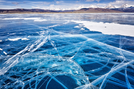 cracks in ice: Beautiful ice in cracks . Its windy. Focus on foreground . Lake Hovsgol . Mongolia