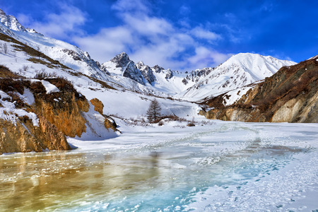eastern sayan: Trail on frozen river in mountains of Eastern Sayan . On this path moving climbers for climbing to tops of mountains . Buryatia . Russia Stock Photo