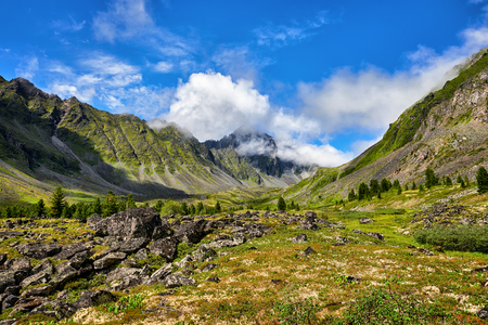 Mountain valley and peak in clouds . Eastern Sayan . Russia Stock Photo