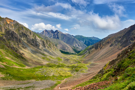 Green alpine meadows in mountain valley . View from above. Eastern Sayan . Russia Stock Photo