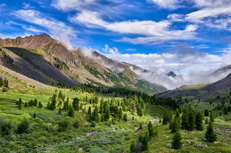 tunka range: Beautiful sky over fabulous mountain valley. Eastern Sayan. Russia