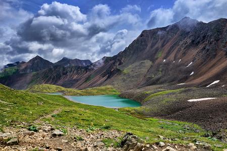Beautiful lake in mountain tundra of Eastern Siberia. Sayan. Russia Stock Photo