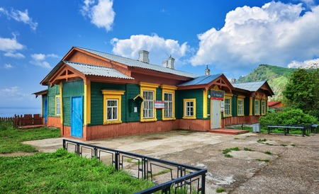 wood structure: MARITUI. IRKUTSK REGION, RUSSIA - July, 29,2016: Building Maritui station Circum-Baikal Railway. Old wooden structure and concrete area in front of structure